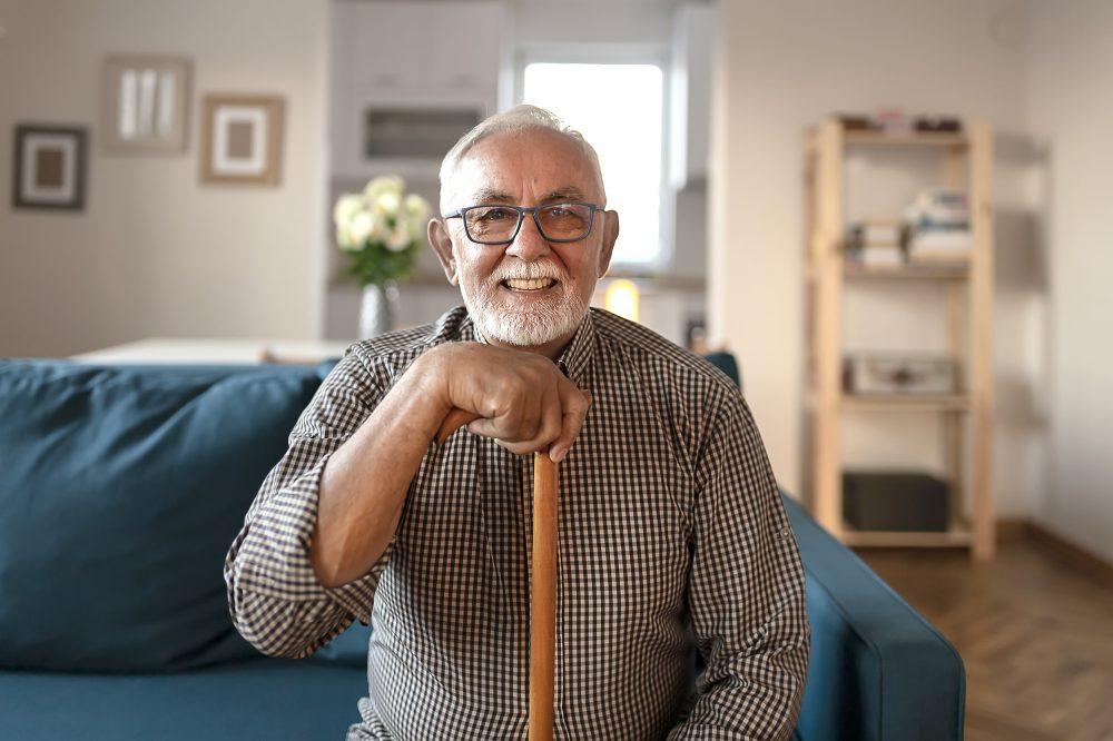Portrait of Happy Senior Man with walking stick